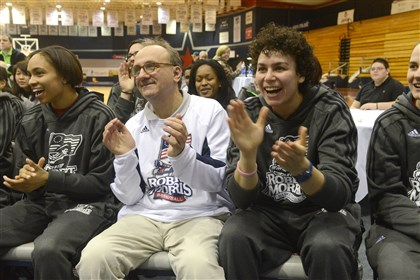20140317rldRMUBracket01 Members of Robert Morris University's women's basketball team, including head coach Sal Buscaglia, center, cheer tonight after it is announced the Colonials will play No. 1 seed Notre Dame in the first round of the NCAA tournament.