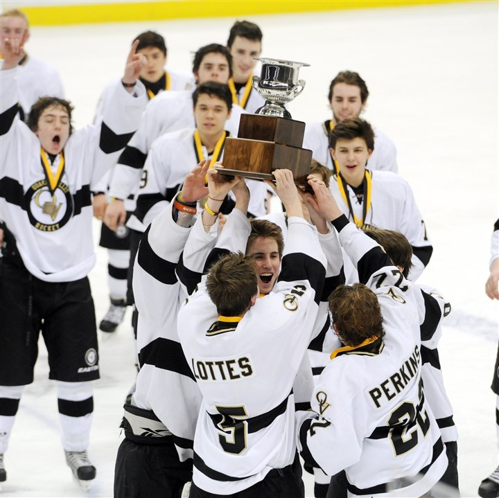 20140317MWHhockeySports01 Quaker Valley raises its trophy Monday after defeating Thomas Jefferson to win the PIHL Penguins Cup Class A championship.