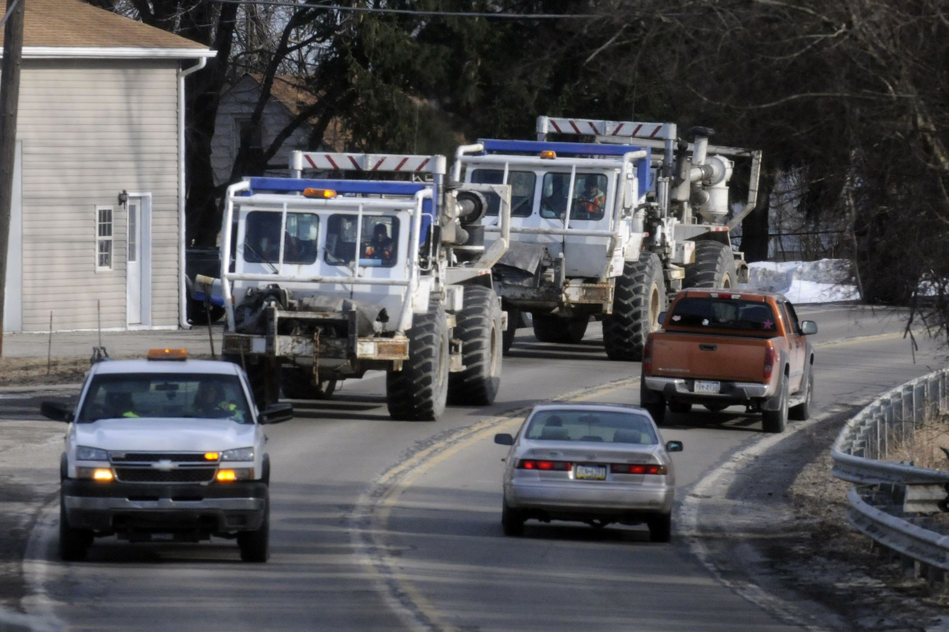 20140318bwSeismic Dawson Geophysical Company seismic testing vehicles return to their overnight parking in Center after a day of work in Aliquippa. Dawson was hired by Seitel, Inc., to survey parts of Beaver and Allegheny counties.