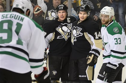 20140318pdPenguinsSports01 Penguins winger Chris Kunitz celebrates with Sidney Crosby after scoring in the first period against the Stars.