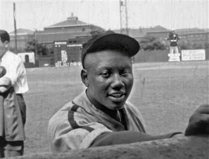 "Homestead Grays catcher Josh Gibson A still from a 16mm film by Charles ""Teenie"" Harris shows Homestead Grays catcher Josh Gibson in September 1945 at Forbes Field."