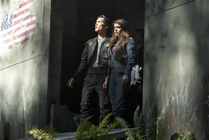 "20140319HOHundred3  Bob Morley as Bellamy and Marie Avgeropoulos as Octavia in ""The 100."""