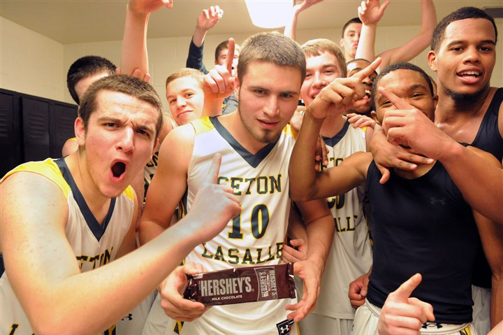 20140318JHSportsBB01 Seton-LaSalle celebrates in the locker room after a 46-44 PIAA AA semi-final win over Greensburg Central Catholic and a trip to Hershey to play in the state championship game Friday.