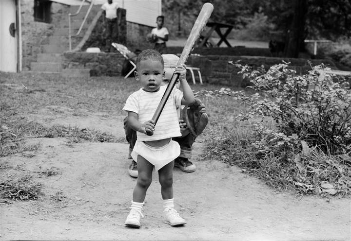 Teenie Harris' grandson Mark Harris Teenie Harris' grandson Mark Harris holds a baseball bat at the family home in Butler, Pa., in August-September 1961. His brothers Scott and Charles are in the background along with neighbor Steve Lehnerd.