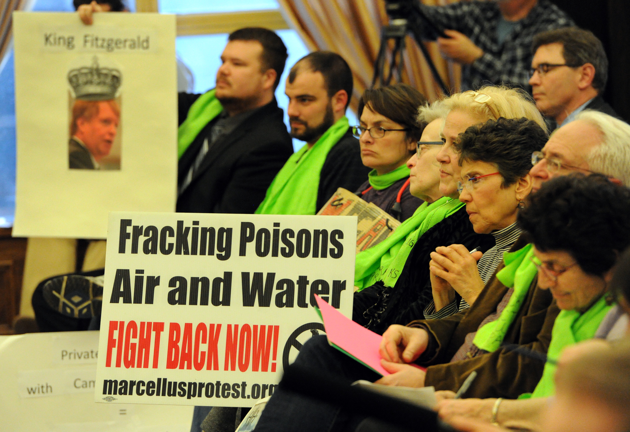 20140318JHLocalDrill04-3 Protesters listen to Executive Rich Fitzgerald talk about the agreement reached for drilling for natural gas under Deer Lakes Park.