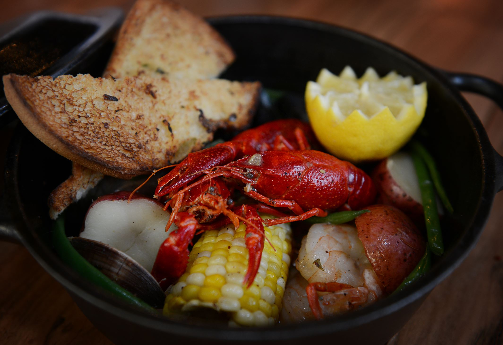 20140318jrTableFood1-1 Ten Penny's American clam bake ($28) is a rustic meal that's big enough to share. Ingredients steamed in Yards Tavern Ale include little neck clams, PEI mussels, shrimp, crawfish, Italian sausage, corn on the cob, red potatoes and haricot vert