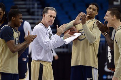 pittbb0320 Pitt coach Jamie Dixon gathers the team during practice Thursday in preparation for their NCAA second-round game today against Colorado at the Amway Center in Orlando, Fla.
