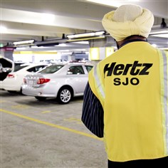 Hertz Spinoff FILE - In this May 9, 2011 file photo, a Hertz rental car worker checks out cars at San Jose International Airport in San Jose, Calif. Hertz on Tuesday, March 18, 2014 said it plans to spin off its equipment rental business into a separate publicly traded company. (AP Photo/Paul Sakuma, File)