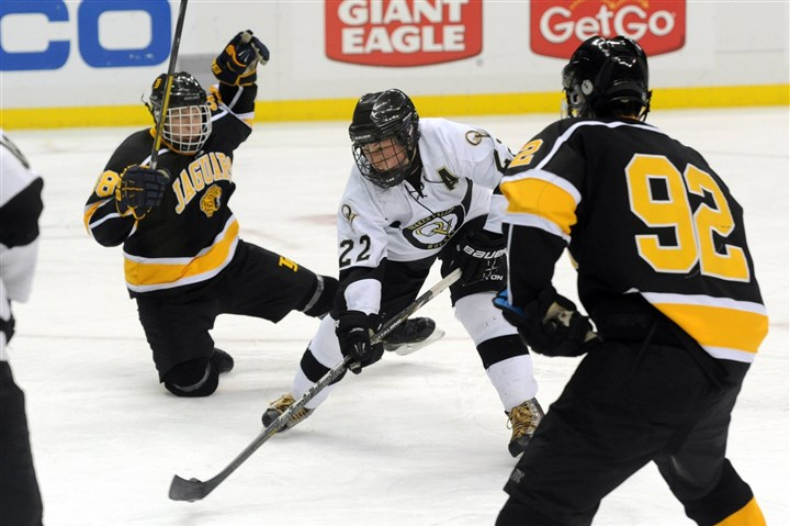 Photographer Quaker Valley forward James Perkins carries the puck between two Thomas Jefferson defenders to score a goal in Class A Penguins Cup Championship match at Consol Energy Center on Monday.