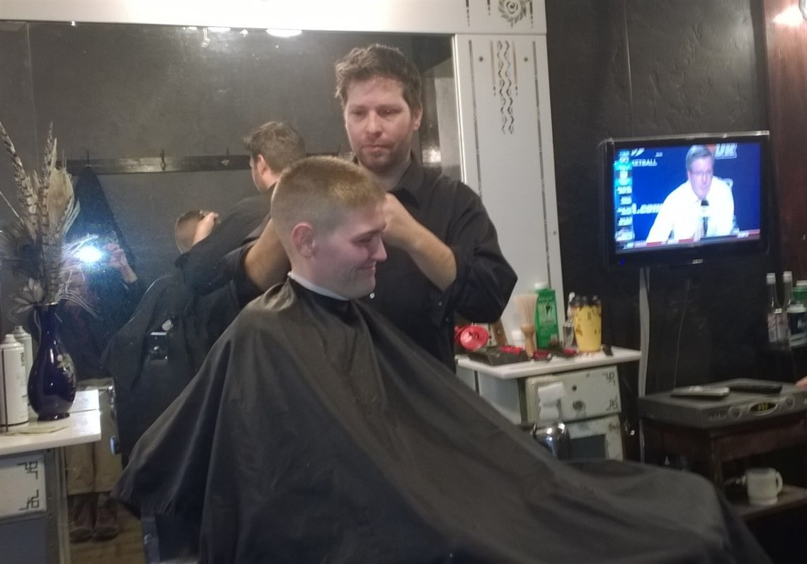 Aaron Stubna, Owner Of The Lincoln Barbershop In Bellevue, Cuts Jay  Hannan's Hair