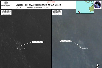 Australia Malaysia Plane In this March 16, 2014 satellite imagery provided by Australia's Department of Defence on Thursday, a floating object, possibly debris from Flight MH370, is seen at sea.