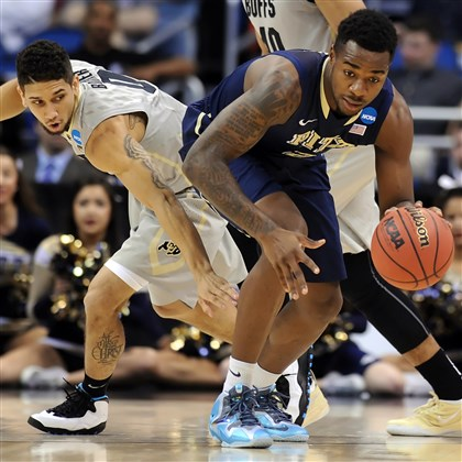 Michael Young Pitt's Michael Young steals the ball from Colorado's Askia Booker in the first half of a second-round NCAA tournament game Thursday afternoon at the Amway Center in Orlando, Fla.