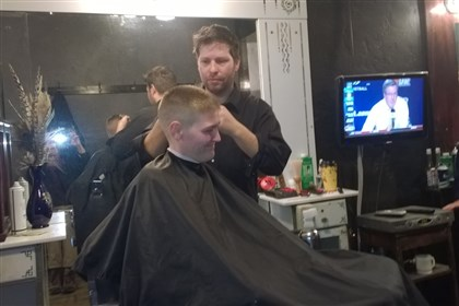 20140320DHbarbershoplocal Aaron Stubna, owner of the Lincoln Barbershop in Bellevue, cuts Jay Hannan's hair. Mr. Stubna says Shenango should be required to comply with air quality rules or be shut down.
