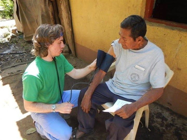Nicaragua RMU pre-med student Wes Heinle treats a patient at the medical clinic in Granada, Nicaragua.