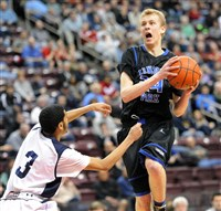 Lincoln Park's Maverick Rowan, right, (with the ball) is fouled during first half action of the PIAA Championship game at the Giant Center in Hershey, Pa. March 21, 2014