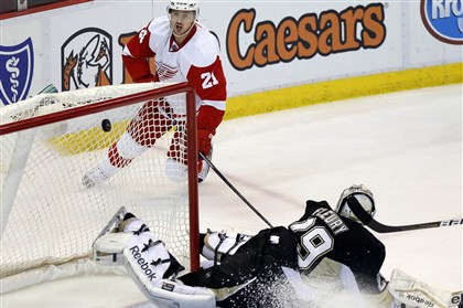 Penguins Red Wings Hockey Detroit's Tomas Tatar watches the puck sail into the goal behind Penguins goalie Marc-Andre Fleury to tie the game at 3-3 in the third period.