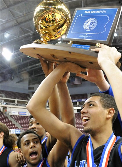 Lincoln Park Renell Cummings and Dermotti Welling Lincoln Park Renell Cummings, left, and Dermotti Welling, right, hold the trophy as Lincoln Park defeated Math, Civics & Science Charter School for the PIAA Class A championship at Giant Center in Hershey, Pa.