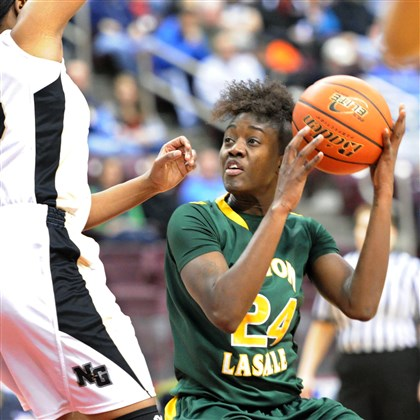 Seton wins Neuman-Goretti's Tanesha Sutton, left, guards Seton-LaSalle's Yacine Diop, right, first half action of the PIAA Class AA state final at the Giant Center in Hershey, Pa.