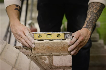 Scott Snyder, 27, of West View Scott Snyder, 27, of West View, builds a brick pizza oven at the Trade Institute of Pittsburgh.