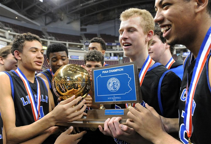 0140321JHSportsPIAA13 Lincoln Park Maverick Rowan, (second from right) holds the trophy after scoring 37 points as Lincoln Park beats Math, Civics & Science Charter, 70-66, in the PIAA Class A championship Friday at Giant Center in Hershey, Pa.