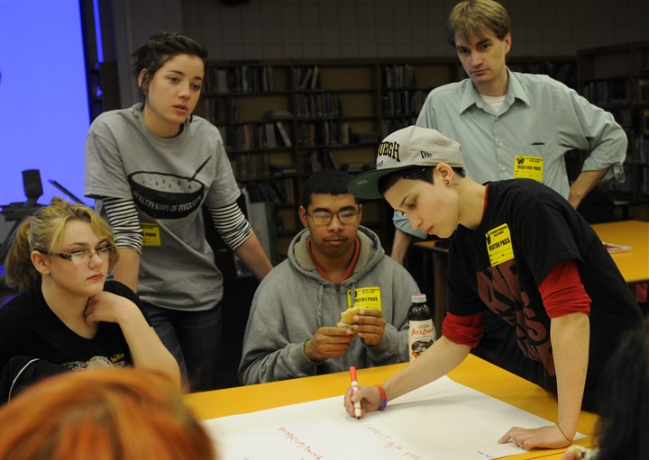 Gay-Straight Alliance at Pittsburgh Sto-Rox sophomore Karina Smeresky, right, writes plans during a brainstorming session to raise awareness of the National Day of Silence on April 11. In the group are, from left, Brooke Schaeffer, a Sto-Rox sophomore; Alyssa Stever, from Pitt; Darius Michael, a Sto-Rox sophomore, and Joe Herzing, a Sto-Rox guidance counselor. The Gay-Straight Alliance at Pittsburgh Brashear High School hosted the planning session.
