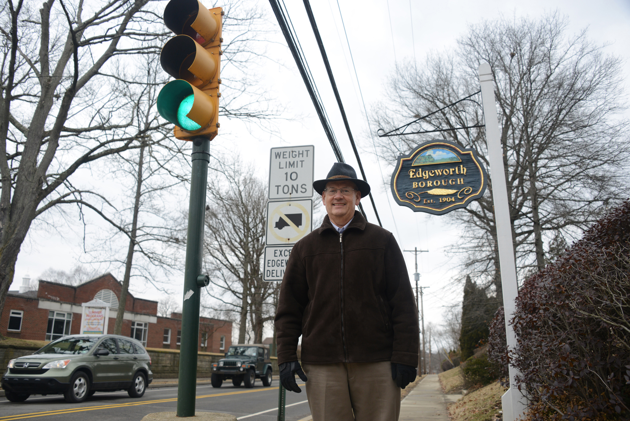 201403225lfLEDStreetLights In Edgeworth, borough manager Marty McDaniel saved a lot of money switching his stop lights to LEDs. Here he is at the corner of Beaver Street and Academy Avenue.