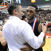 New Castle basketball coach Ralph Blundo congratulates Malik Hooker after undefeated New Castle beat La Salle in the PIAA championship game in 2014.