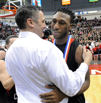 20140322JHSportsPIAA34-1 New Castle coach Ralph Blundo, left, congratulates Malik Hooker, right, after undefeated New Castle beats La Salle in the PIAA Championship game at the Giant Center in Hershey March 22.