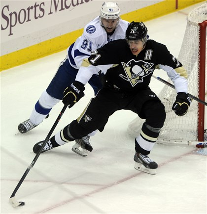 20140322ppPens3SPTS-2 Penguins center Evgeni Malkin controls the puck against Tampa Bay Lightning's Steven Stamkos Saturday in a game at Consol Energy Center.