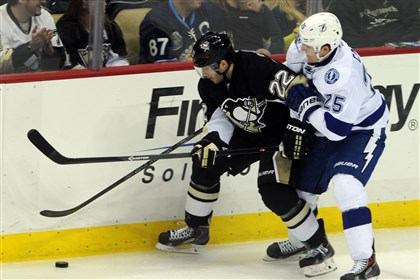 20140322ppPens5SPTS-4 Lee Stempniak battles with hte Tampa Bay Lightning's Matthew Carle Saturday at Consol Energy Center.