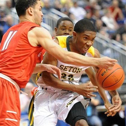 clancy0323 Constitution's Floyd Preito, left, fouls Seton-LaSalle's Dale Clancy in the Class AA final in Hershey, Pa.