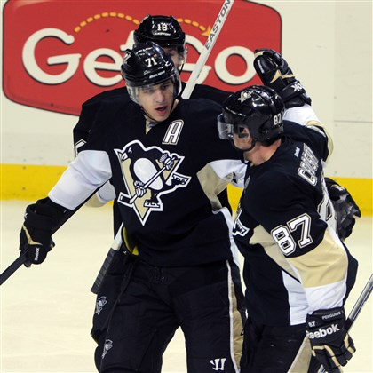 Evgeni Malkin Evgeni Malkin, shown here being congratulated by teammate Sidney Crosby after scoring his first of two goals against Tampa Bay on Saturday, will be out for several weeks with a foot injury.