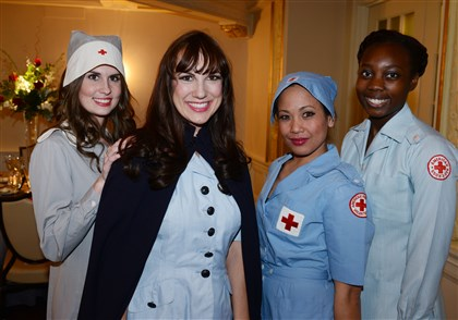 20140322bwCrossSeen02-1 Wearing vintage Red Cross nurse outfits are from left, Nicole Pulcini, Shellie Hipsky, Gail Alberto-Martin and Sahara Duncan.
