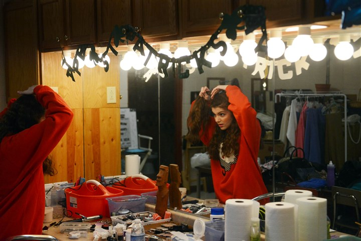 "Footloose Senior Catherine Paletta checks her hair before the start of Mars Area High School's rendition of ""Footloose"" on opening night last Friday."