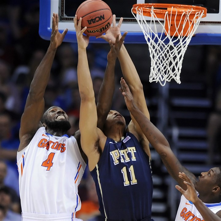 Pitt's Derrick Randall reaches for rebound vs. Florida Pitt's Derrick Randall reaches for a rebound against Florida's Patric Young in the first half of the third round of the NCCA tournament at Amway Center in Orlando.