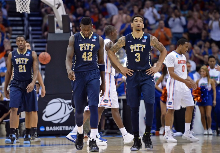 20140322mfpittsports07-6 Pitt's Lamar Patterson, Talib Zanna and Cameron Wright walk off the floor after a timeout late in the second half against Florida Saturday in the third round of the NCAA tournament at Amway Center in Orlando, Fla.