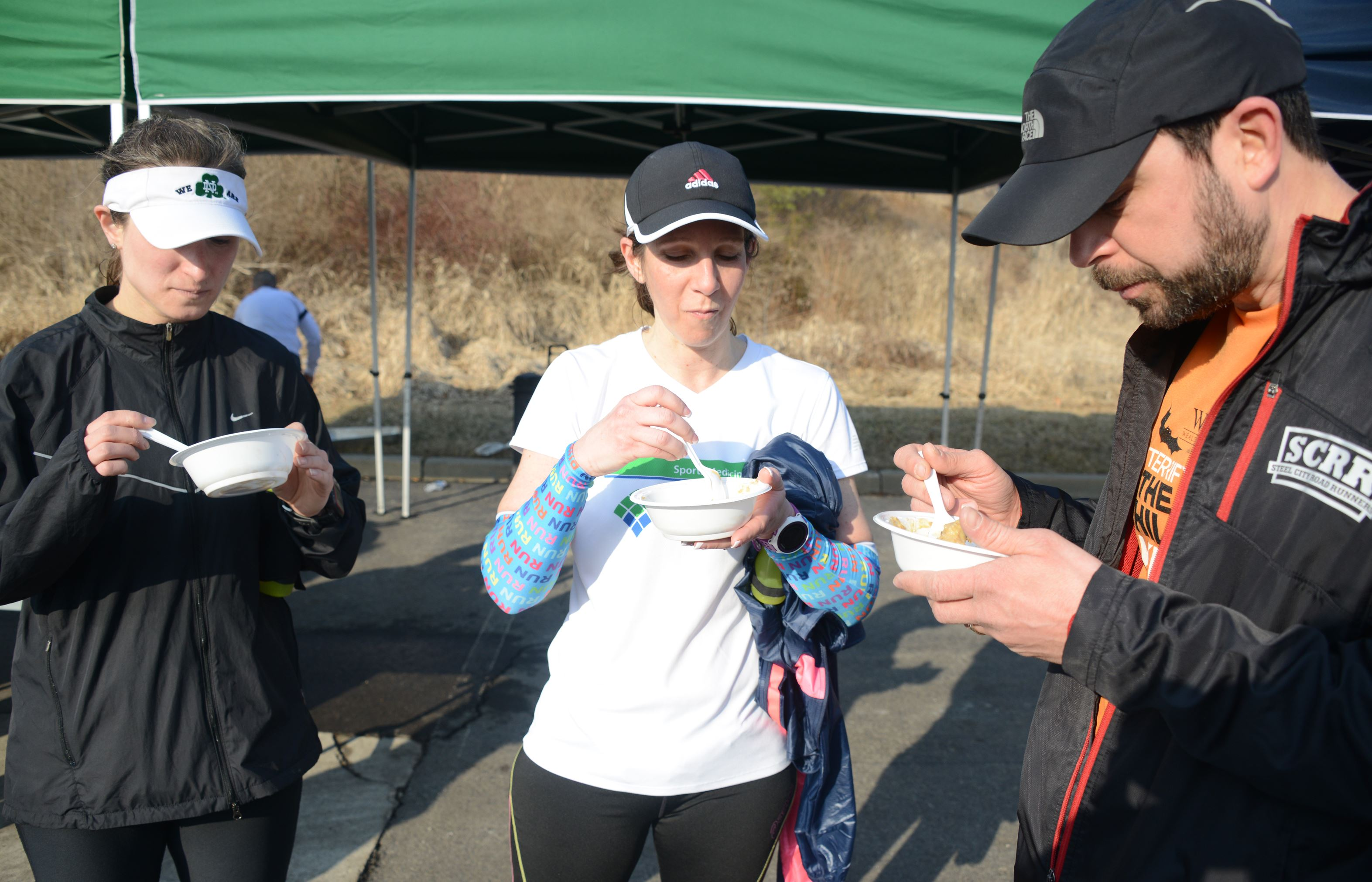 26.2 Food: Butternut squash oatmeal 03 Jennifer Garczyk of Squirrel Hill, Francie Sukitch of Moon and Steve Gaghan of Mars taste a bowl of butternut squash oatmeal prepared by Pittsburgh Marathon dietitian Nick Fischer at the Steel City Runners group run on the Montour Trail in Moon.
