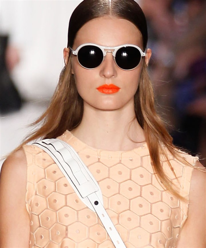 Rag & Bone bold lipstick Orange lip color: A model with a pout that pops in the Rag & Bone spring 2014 runway show at New York Fashion Week.