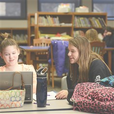 Ingram Resource Center Abigail Johnston, 12, and Katie Steele, 14, help each other with homework at the Ingram Resource Center.