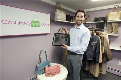 "20140325PIhandbag1biz-1 Michael Zakroff, owner/director of Narberth based internet business CashinMyBag, show off the Hermes ""Kelly Bag."""