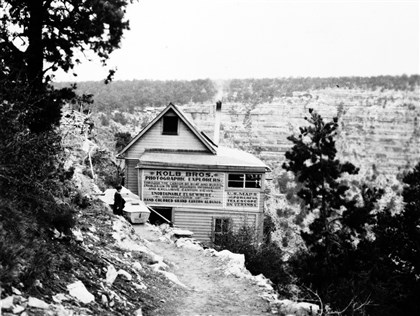 "The Kolb Brothers' studio 1913 The Kolb Brothers' studio with the boat ""Defiance"" in the foreground, south rim of the Grand Canyon, 1913. Photo by Emery Clifford Kolb (1881-1976)."