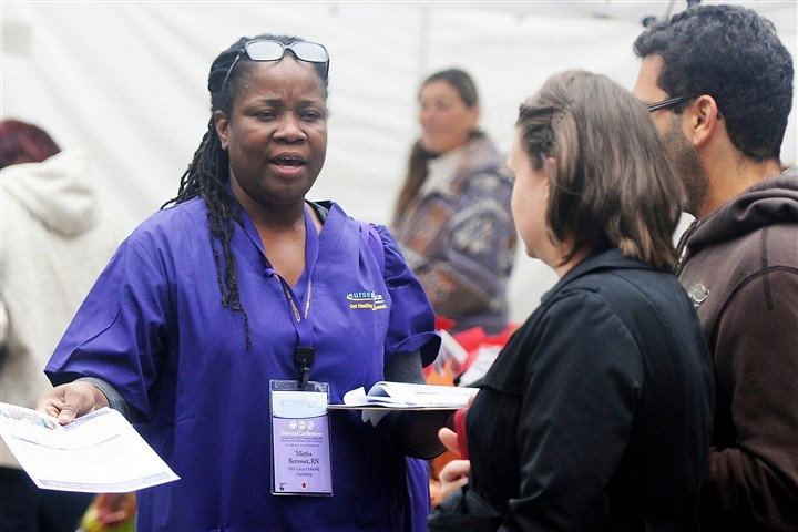 Affordable Care Act Mirtha Berrouet, a registered nurse from New York and a member of the SEIU, hands out information about the Affordable Care Act in Market Square.