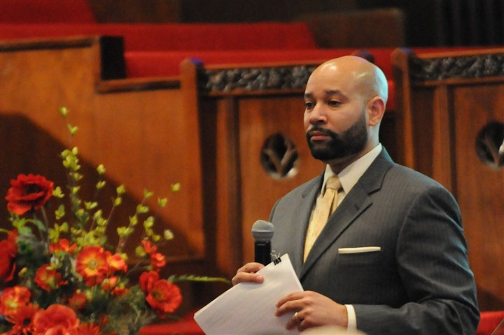 20140325CMLandBankLocal002-1 City Councilman Daniel Lavelle addresses community members during a forum on land banking at the Central Baptist Church in the Hill District.