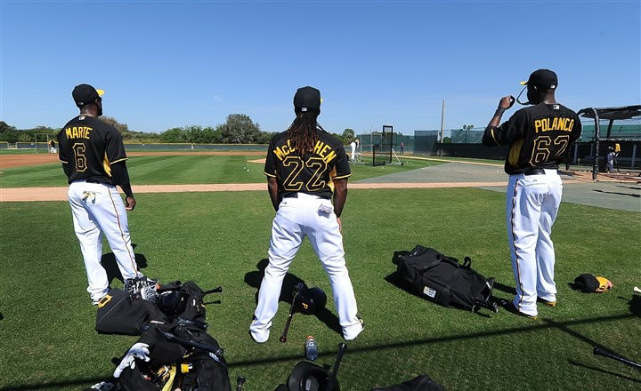 outfield0330-1 Pirates starting outfielders Starling Marte Andrew McCutchen and prospect Gregory Polanco getting loose at spring training.