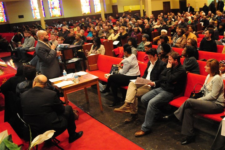 20140325CMLandBankLocal001 City Councilman Daniel Lavelle addresses community members during a forum on land banking at the Central Baptist Church in the Hill District.