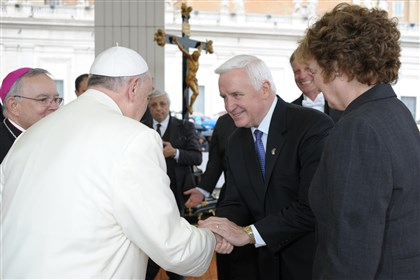 Pope and Gov Corbett Pope Francis shakes hands with Gov. Tom Corbett, center, as Philadelphia Archbishop Charles J. Chaput, left, looks on at the Vatican.