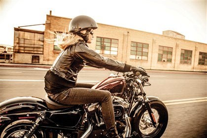 Woman Rides Motorcycle Women who ride motorcycle tend to be happier than their non-riding counterparts.