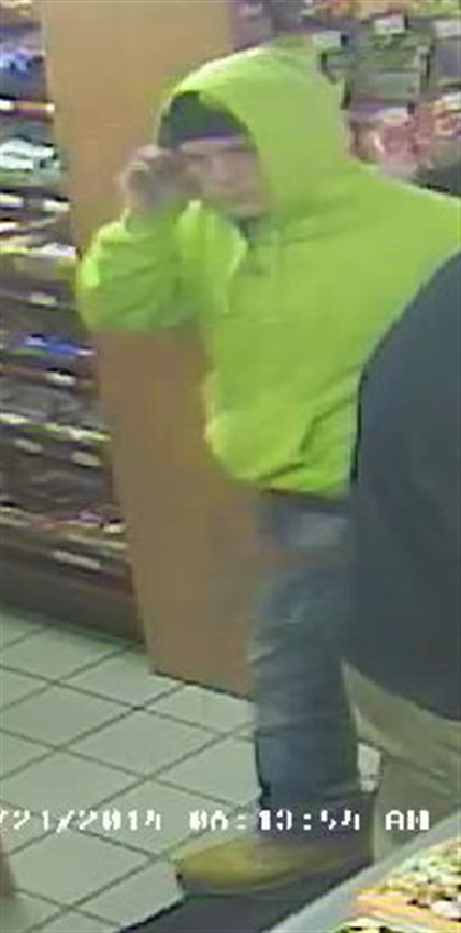 surveillance video 2 Surveillance video shows a man and woman police believe stole credit cards from unlocked cars.