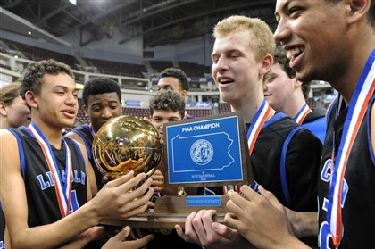 0140321JHSportsPIAA13.jpg Maverick Rowan, second from right, holds the trophy after scoring 37 points in Lincoln Parks victory over MCSCS in the PIAA Championship game Friday in Hershey.