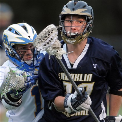 9eo00kqz.jpg Franklin Regional's Connor Cummins moves the ball against Hampton's Jon NIgro during a game last season.